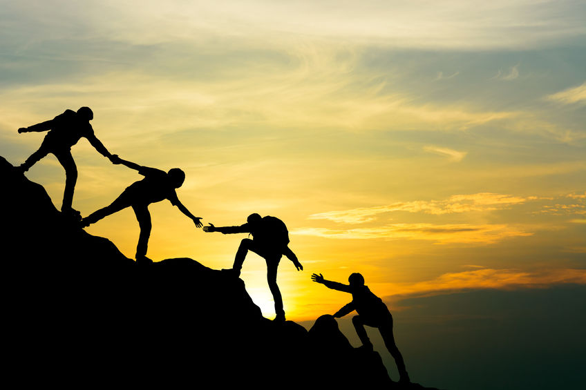 Group of people on peak mountain climbing helping team work with sunset background , travel trekking success business concept